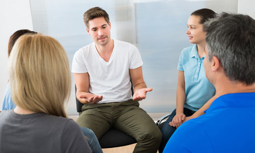Counselling Lancaster - Young male in group counselling