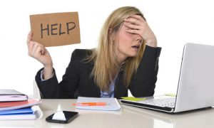 Counselling Lancaster - Woman at desk needing help